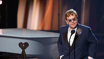 Elton John postpones tour dates after hip injury leaves him 'in considerable pain'