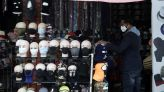 The Latest: Mask sales start to rebound amid surge, guidance