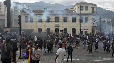 Protesters Throw Tear Gas Back at Police Near Ecuador's Legislative Palace in Quito