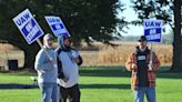 Deere and UAW return to negotiations as community support for strike grows