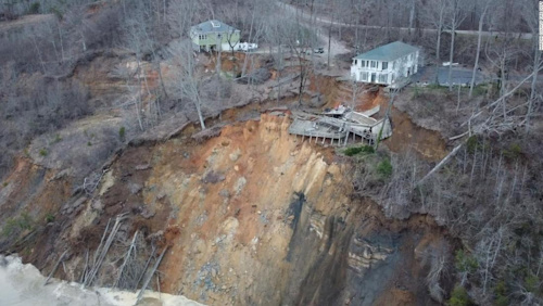 Two homes collapse in landslide along the Tennessee River