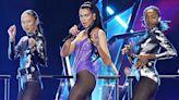 Dua Lipa Slays In Purple Leather Bodysuit & Sheer Black Tights As She Performs In Las Vegas