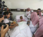 Abdul Rahman Al Sudais, Imam of the Grand Mosque in Mecca, talks to one of the victims of Friday's crane accident at the mosque while visiting Al-Noor specialist hospital in Mecca, Saudi Arabia ...