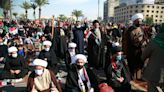 Demonstrators in Iraq take to street unmasked amid pandemic