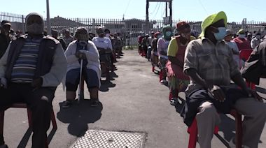 South Africa police help struggling Cape Town elders with food parcels
