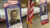 Memorial banners for veterans adorn the city of Wellsburg