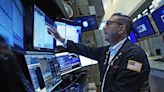 Stock markets weather wobbly day, end mixed