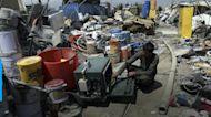 Ahead of exit, U.S. trashes gear in Afghanistan scrap yards