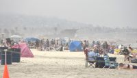 Visitors fill San Diego beaches as heat wave hits the Pacific Southwest