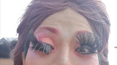 Drag queen struggles with fake eyelashes while riding a motorcycle
