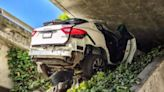 Driver wedges his girlfrend's $78,000 Maserati under freeway after 100mph chase