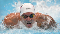 Caeleb Dressel Ties 100m Butterfly Olympic Record in Qualifying Heats