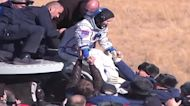 Russian film crew returns to Earth in Soyuz capsule