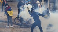 Protesters clash with police in Colombia over proposed tax plan