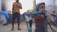 Families mourn as Brazil hits 400,000 COVID deaths