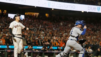 Umpire calls Wilmer Flores out on questionable check swing strike three to end NLDS Game 5