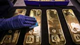 Gold prices notch a slight gain, but end below $1,800 for a second session
