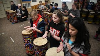Balboa Elementary music teacher teaching African rhythms with new tubano drums purchased with grant money