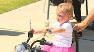Toddler motorcycle fan gets big bike birthday parade