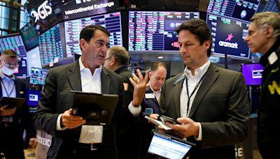 美股早盤漲400點 企業財報和經濟數據優於預期