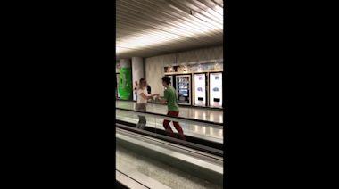 Couple beats flight delay with impromptu salsa performance on airport walkway