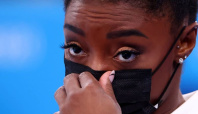 Olympics-Biles withdraws from two finals, Ledecky and Dressel light up the pool