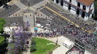 Drone footage shows massive crowds of Argentines queuing to pay respects to hero Maradona