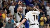 Clinching a fourth straight playoff berth was pleasing to Brewers. But it won't be party time until they win the division.