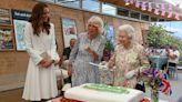 Kate Middleton, Camilla Bowles giggle as The Queen uses ceremonial sword to cut cake