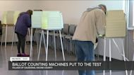 Poll workers test ballot-counting machines ahead of the presidential Election