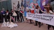 'Debt collector' protesters demonstrate outside IMF