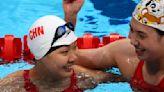 Olympics-Swimming-China smash expectations, world record to win relay gold