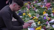 Mourners lay flowers at Windsor Castle for Prince Philip