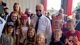 Biden denies being duped into posing for photo with children wearing MAGA hats