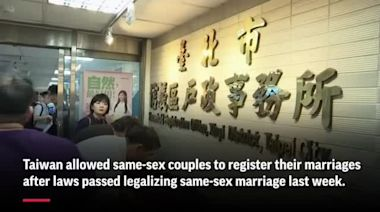 Taiwan allows gay couples to register marriages
