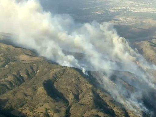 60,000 evacuated in Orange County as wind-driven brush fire rapidly swells to 2,000 acres