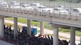 Shock video shows up to 1,000 migrants huddled under bridge at US-Mexico border