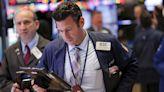 Stocks flirt with records as earnings season rolls on