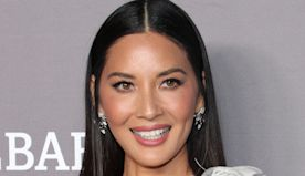 Olivia Munn Chooses Beige Shorts, Muscle Tee & Work Boots While Channeling Her Inner Adventurer
