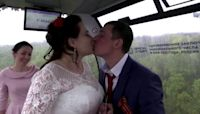Love is in the air: 30 couples marry on cable car
