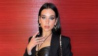 Dua Lipa Wore a Leather Bra Under Her Pinstripe Blazer