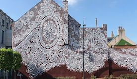 Warsaw-Based Artist Spray-Paints A Beautiful Lace Mural On The Side Of A French Lace Museum