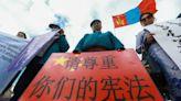 Threats of arrest, job loss and surveillance. China targets its 'model minority'