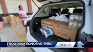 People line up for food donation drive-thru