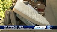 Trash heaps overflowing out of dumpsters around Marquette campus