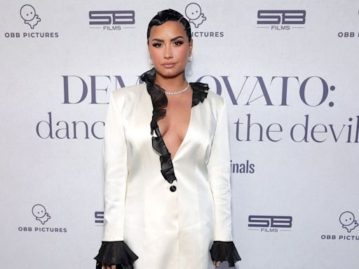 Demi Lovato says they were 'shedding all of the gender norms' placed on them when they cut their hair short