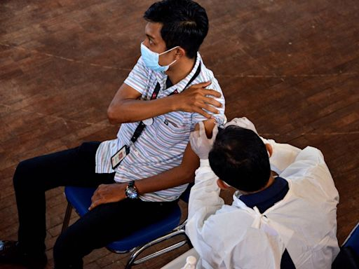 More than 350 Indonesian healthcare workers vaccinated with China's Sinovac vaccine got COVID-19 and dozens are hospitalized, raising questions about the vaccine's efficacy on variants
