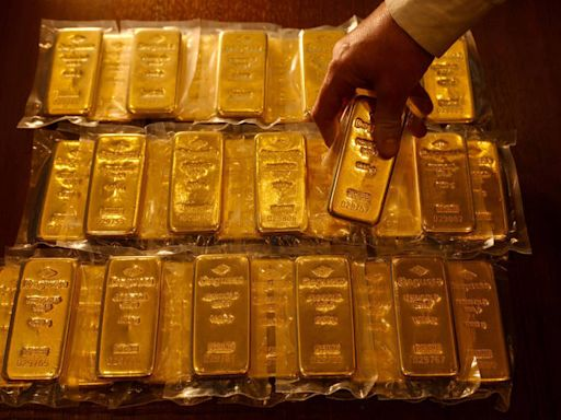 鮑爾縮減購債言論後 黃金收高但脫離盤中高點 - 自由財經