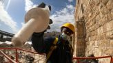 Battered stones of Jerusalem's Western Wall get the full treatment