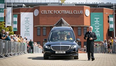 Celtic players and fans applaud Charlie Gallagher after Lisbon Lion's funeral